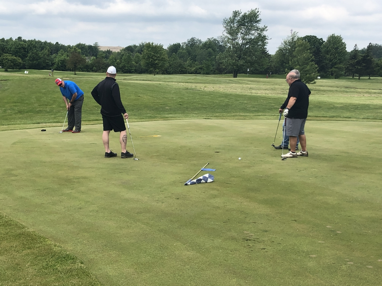 A team putting at the CLOSEST TO THE PIN hole